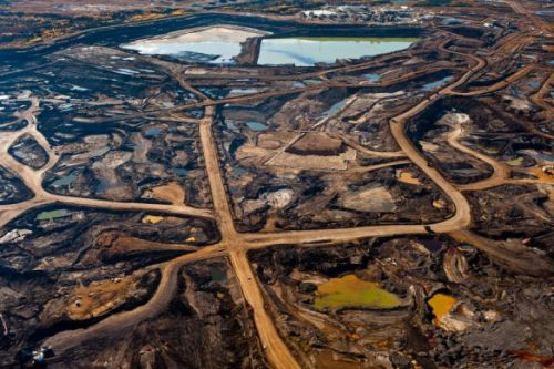 Tar Sands' hellish landscape of ruined Earth and toxic tailing ponds. Image source Occupy.